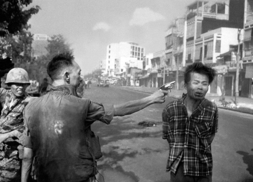 ** EDS NOTE: GRAPHIC CONTENT ** South Vietnamese Gen. Nguyen Ngoc Loan, chief of the National Police, fires his pistol into the head of suspected Viet Cong officer Nguyen Van Lem (also known as Bay Lop) on a Saigon street Feb. 1, 1968, early in the Tet Offensive. (AP Photo/Eddie Adams)